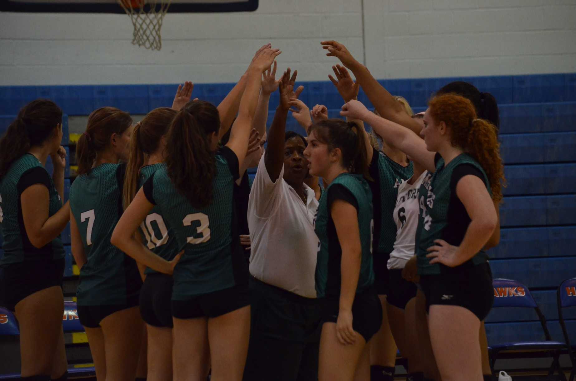 Raptor volleyball's fierce leader Coach Williams leads the team huddle before the win against the Hanahan Hawks.