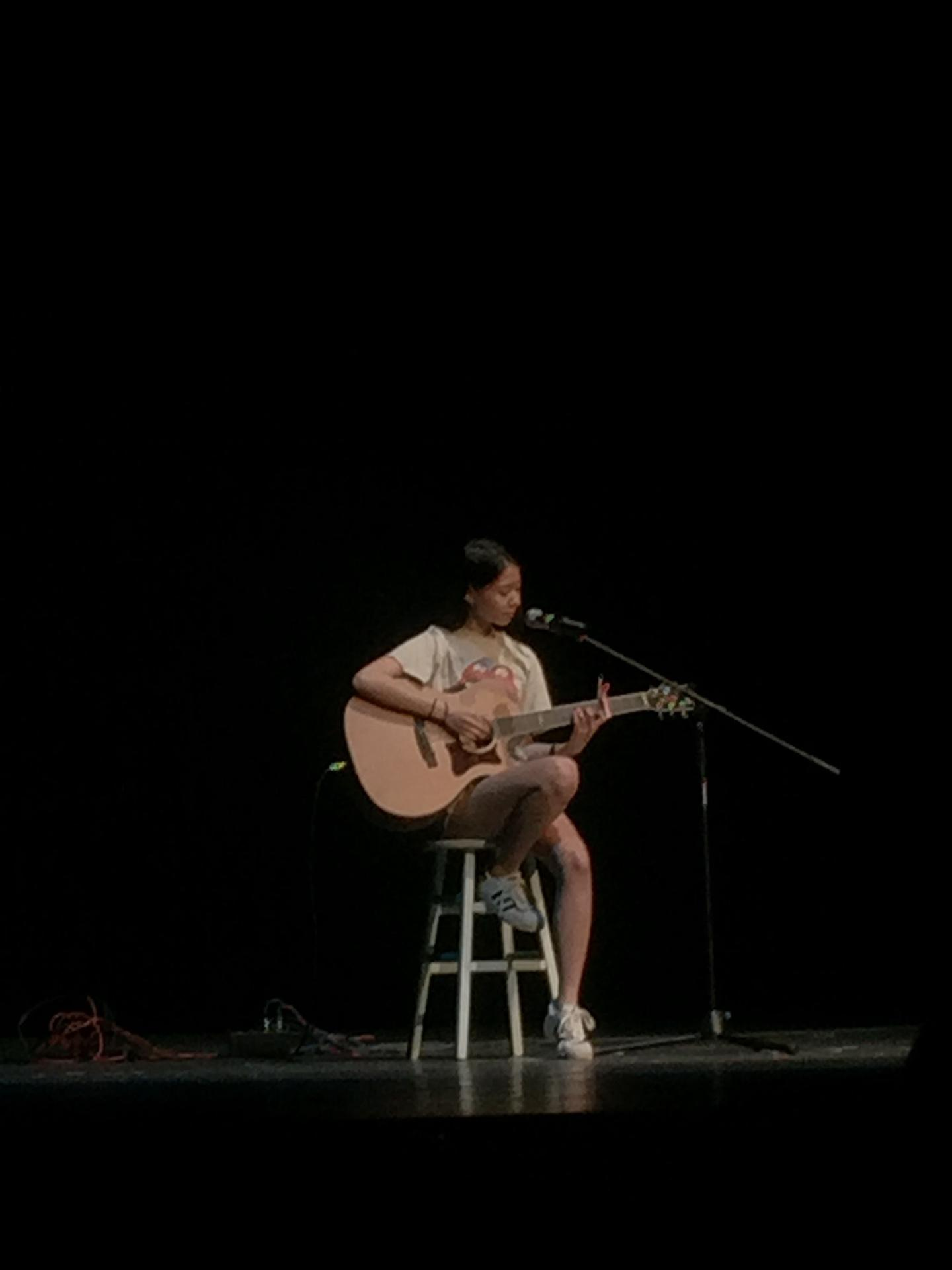 Isabelle Liu (junior) plays and sings The Man on the guitar 3RD PLACE