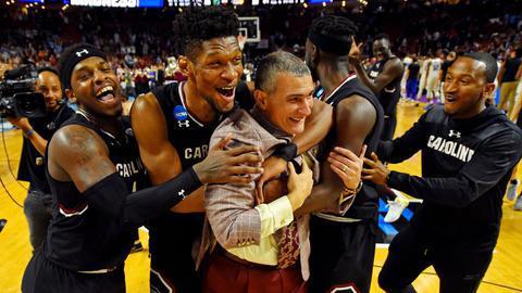 Chris Silva and Rakym Felder celebrating with Coach Frank Martin after their 88-81 win over Duke