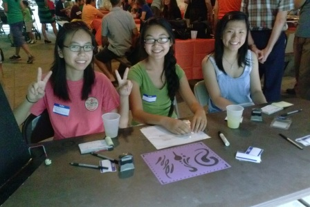 (From left to right) Nancey Fang (grade 12), Kerri Wong (grade 10), and Linda Fang greet and register guests.