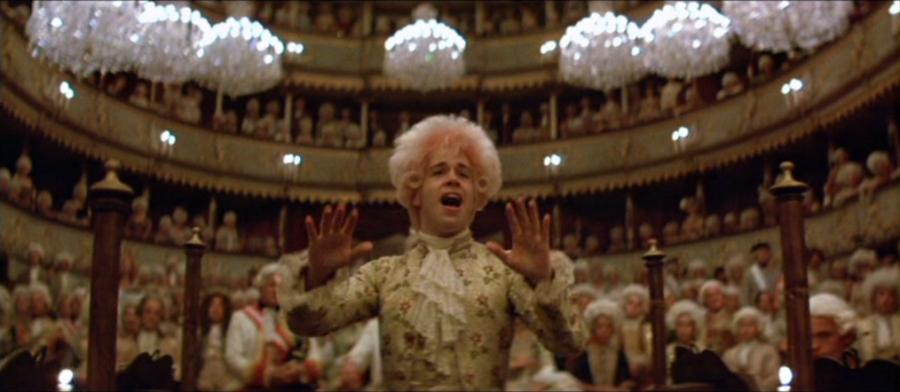 Tom Hulce as Wolfgang Amadeus Mozart, conducting one of his pieces