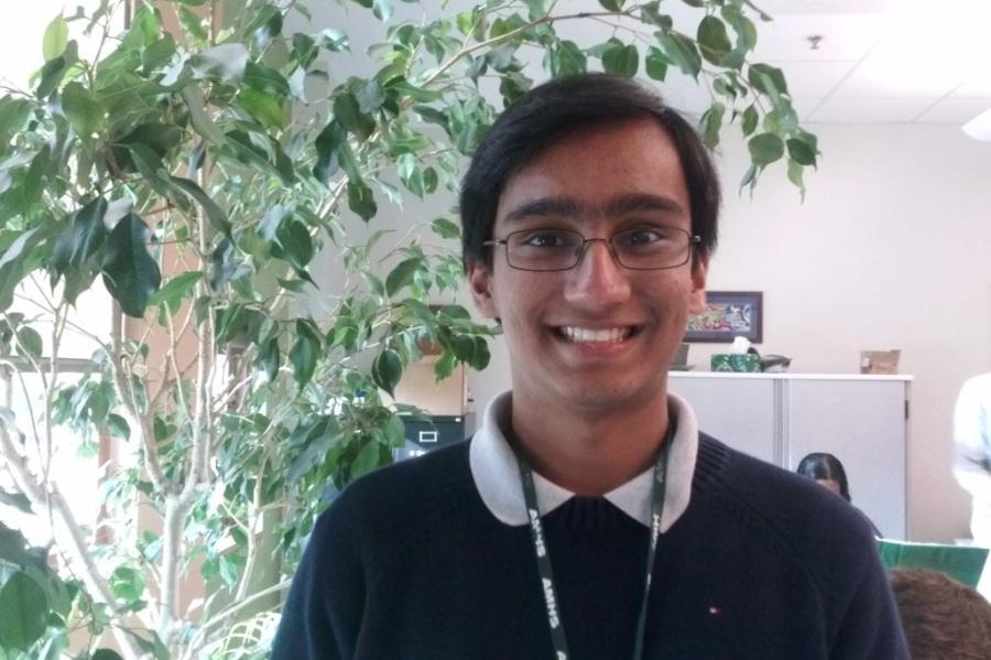 Senior+Vaibhav+Mohanty+next+to+Francis+the+Ficus%2C+the+photosynthesizing+mascot+of+Mr.+Johnston%27s+room