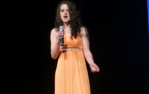 Helen Dubois (12) sings