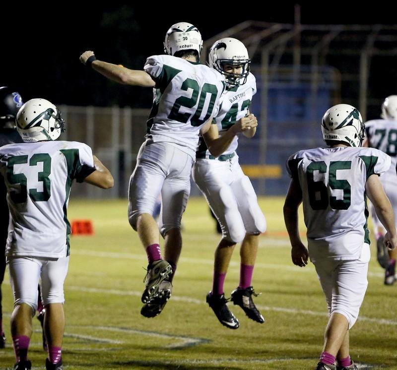 Senior Andrew Alberg (20) celebrates with Potter Seibels after Albergs 3rd Quarter Touchdown