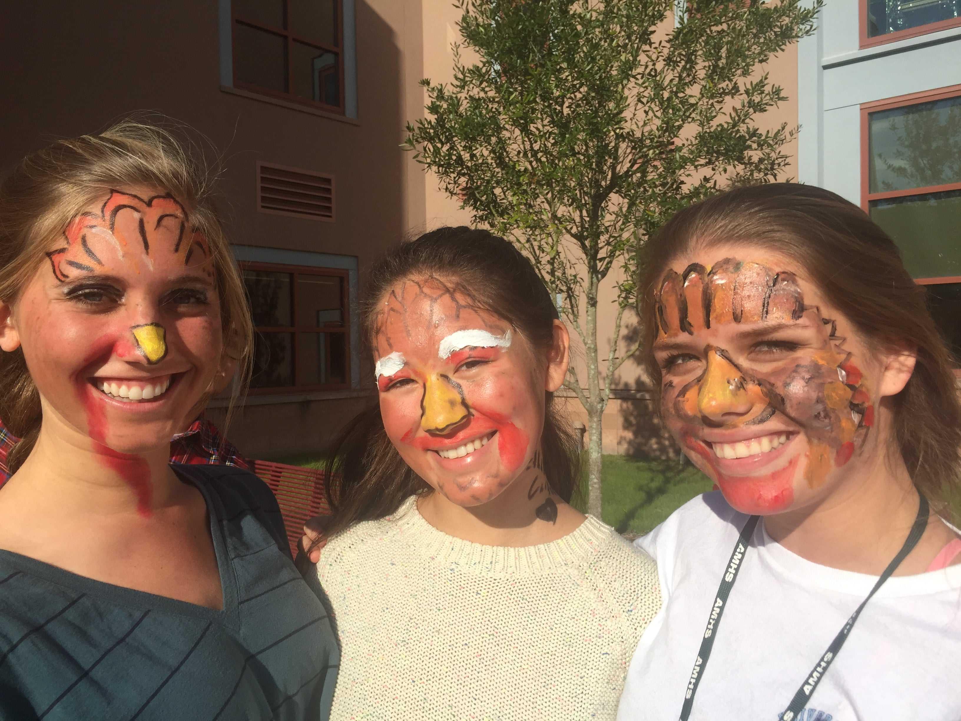 Contestants Hallie Roerden, Mika Sakamoto, and Amber Thomas show off their Turkey Faces