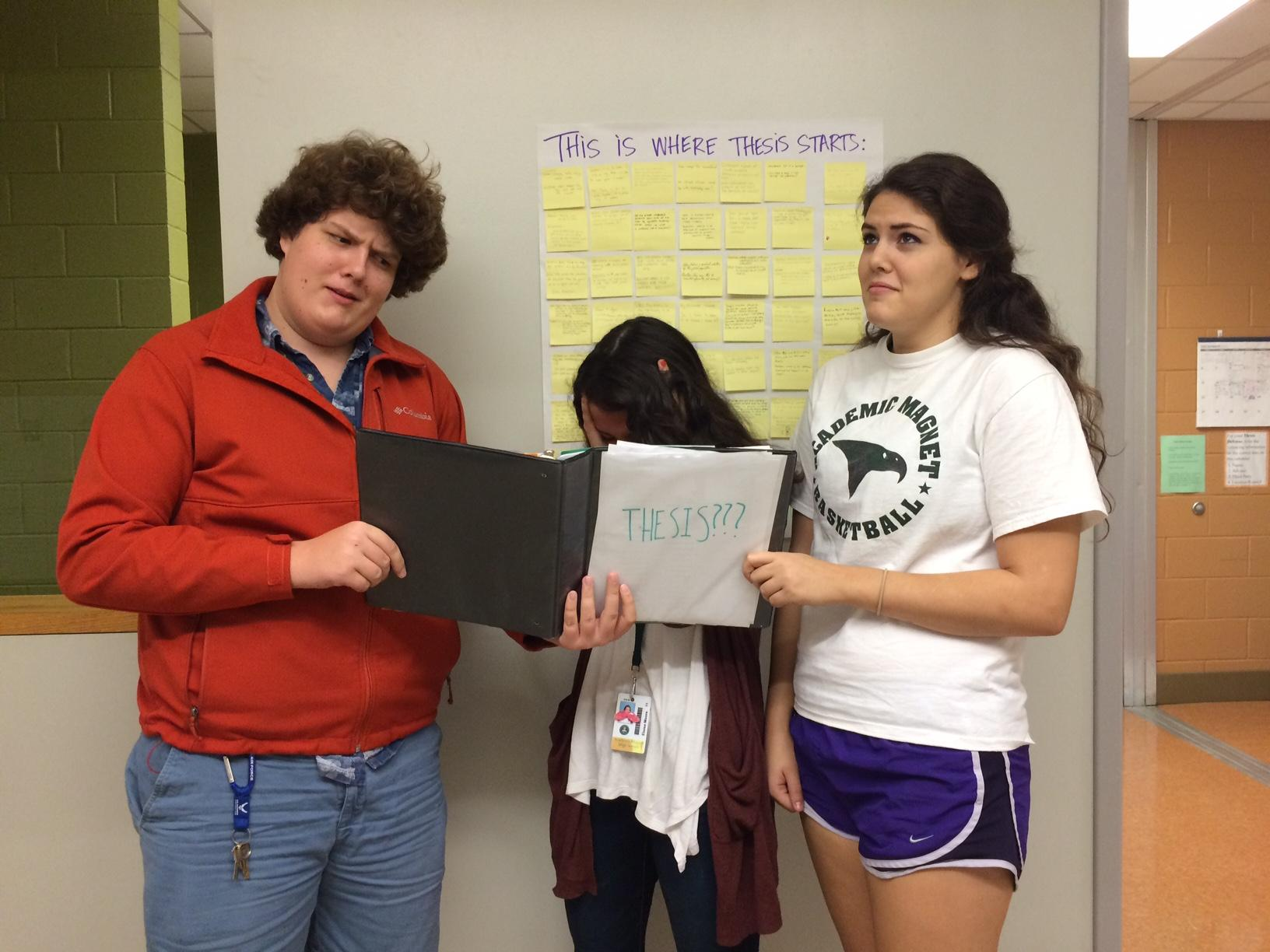 Juniors Liam Rowley, Ellie Moore, and English Laserna cry about thesis.