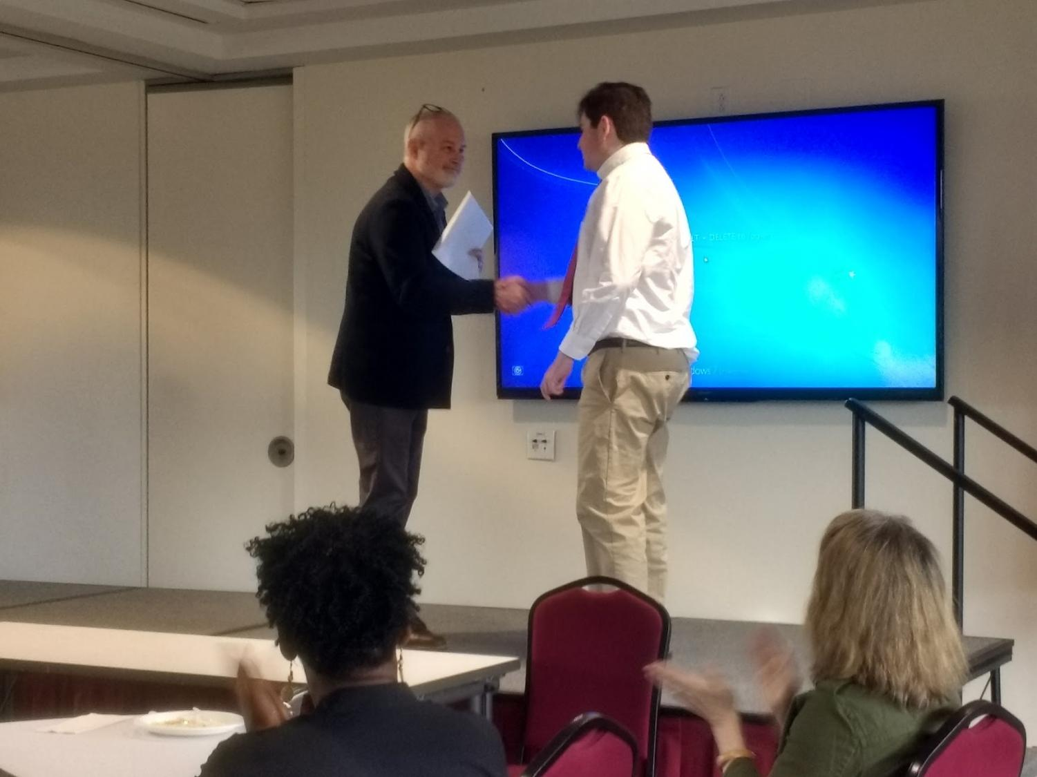 Zachary+Kronsberg+receiving+his+award+for+his+research+project.