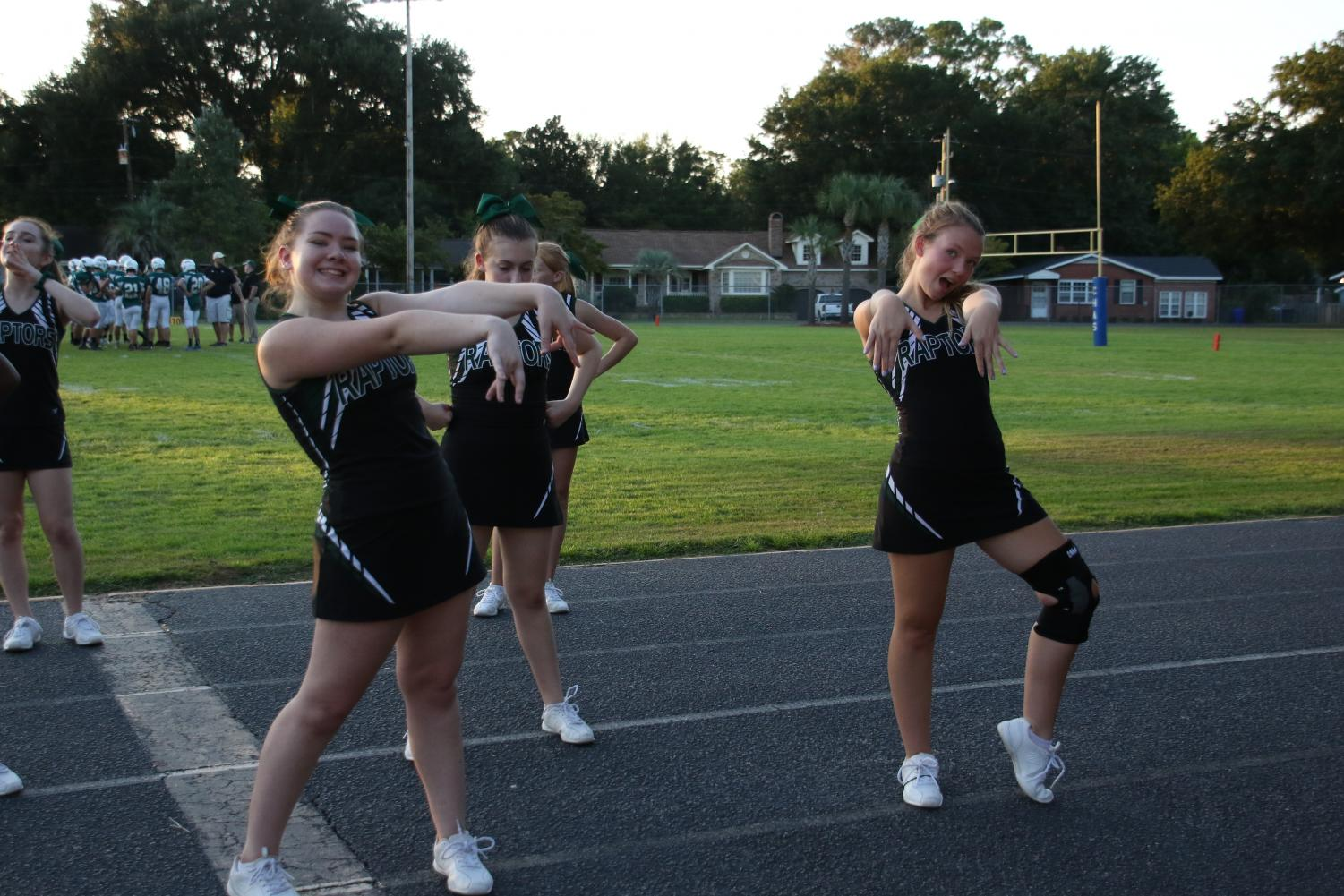 Seniors from the leadership team, Jessica Forney and Sarah Romagnuolo, pose at a raptor football game.
