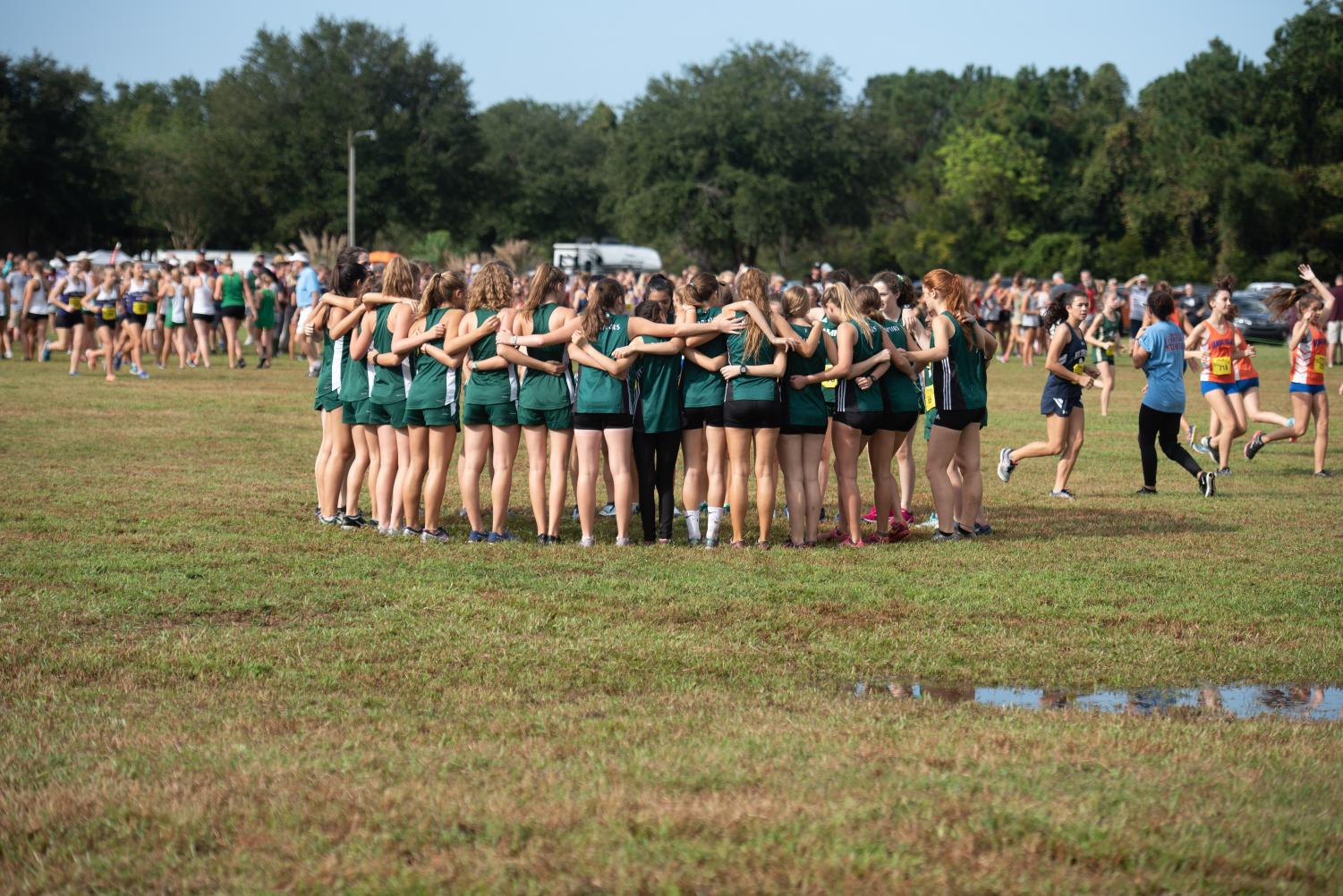 Girls Cross Country team getting hyped before the start