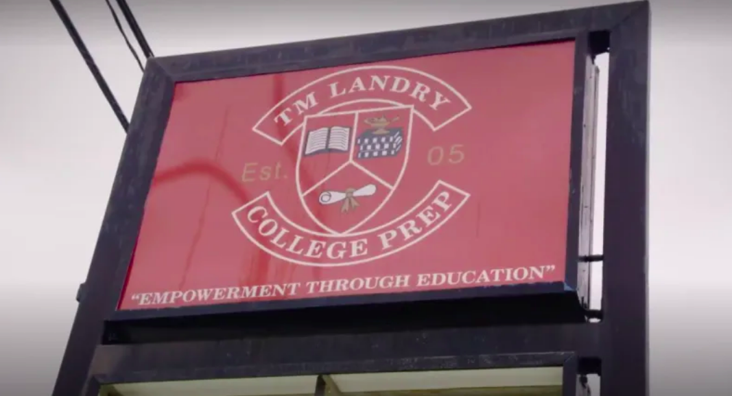 TM Landry's now-infamous crest outside of the school, a ware house-esque building in suburban Louisiana