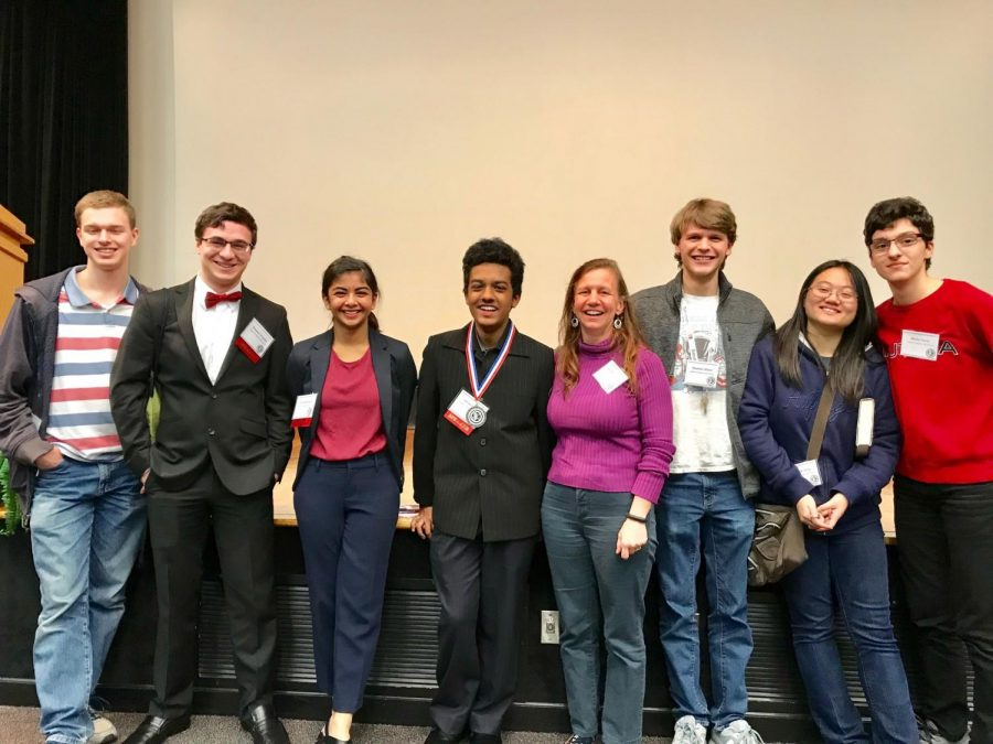 AMHS Science Club Students excited about their award winning research. Pictured left to right: John Paradise, Greg Znokyo, Disha Qanungo, Ishraq Haque, Ms. Katy Metzner-Roop, Stephen Hilton, Angela Yang, and Matteo Pavic.