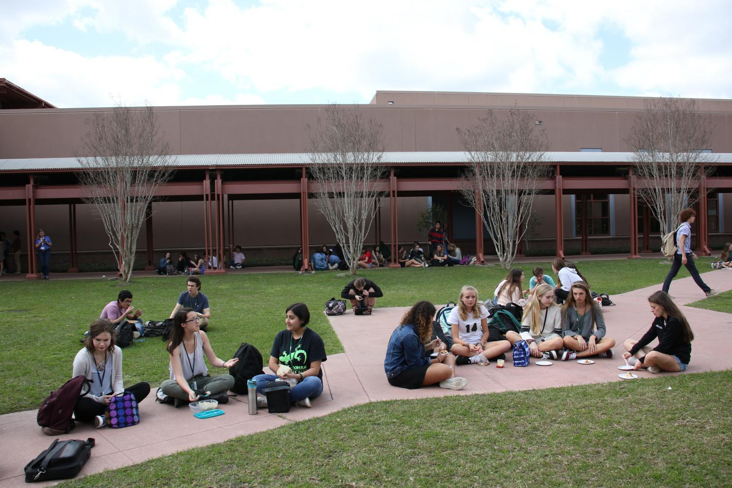 Students+gathered+in+the+courtyard+for+the+pi+day+performances.+