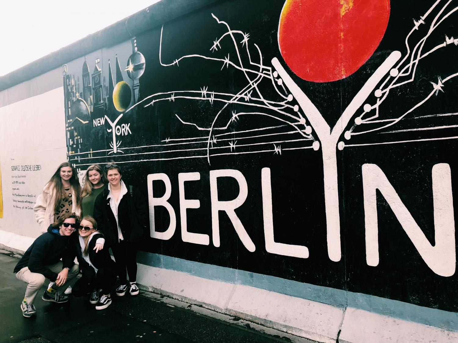 Magnet seniors next to a piece of the Berlin Wall.  Also Caroline Hyde.