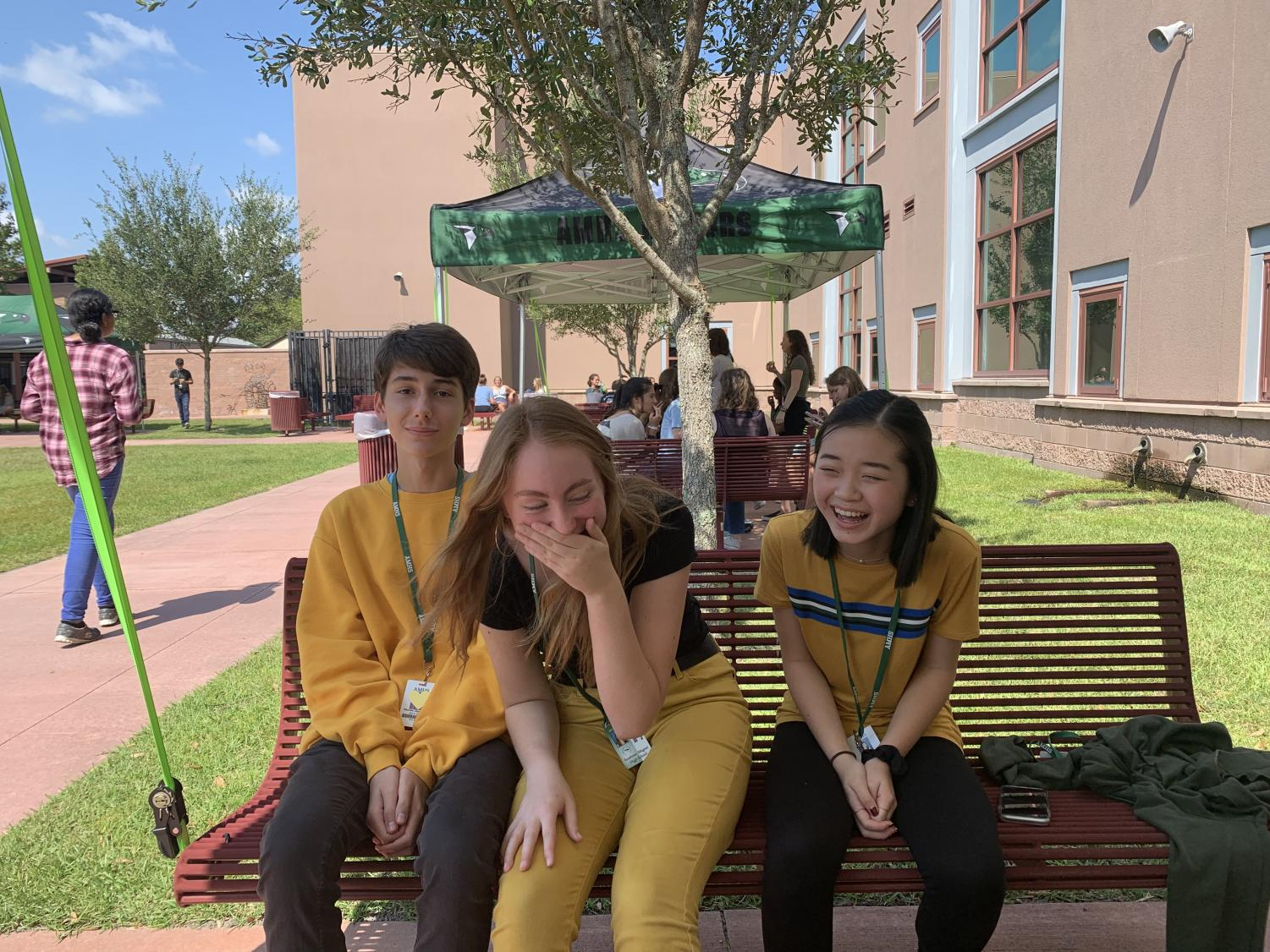 (From left to right) Charlie, Bailey, and Joy wearing their coordinated outfits