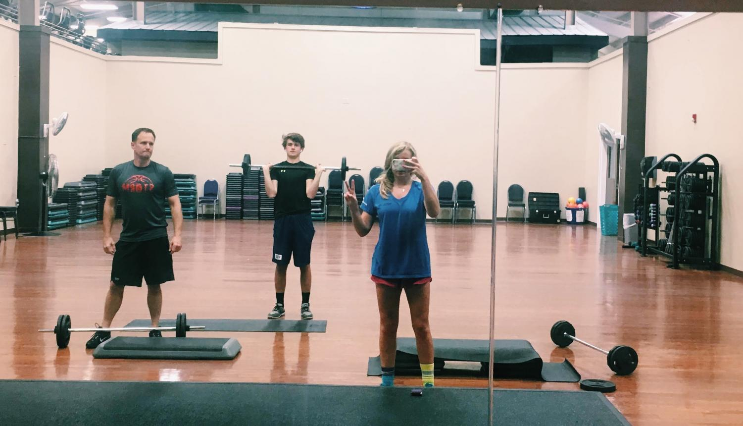 Me, my brother, and my dad preparing for Body Pump