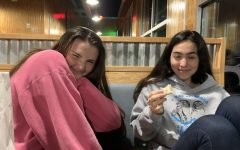 Presidents Angeline Krupa (left) and Gabby Ziegler (right) discussing Nihilism over dinner at Cookout.