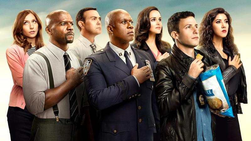 From left to right: Gina Linetti, Terry Jeffords, Charles Boyle, Captain Holt, Amy Santiago, Jake Peralta, and Rosa Diaz