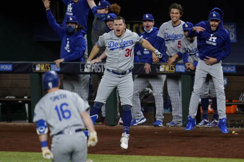 ARLINGTON%2C+TX+-+OCTOBER+16%3A++Will+Smith+%2316+of+the+Los+Angeles+Dodgers+rounds+the+bases+as+Joc+Pederson+%2331+and+the+dugout+celebrates+after+hitting+a+go-ahead+three-run+home+run+in+the+sixth+inning+during+Game+5+of+the+NLCS+between+the+Atlanta+Braves+and+the+Los+Angeles+Dodgers+at+Globe+Life+Field+on+Friday%2C+October+16%2C+2020+in+Arlington%2C+Texas.+%28Photo+by+Cooper+Neill%2FMLB+Photos+via+Getty+Images%29