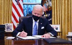 President Biden signs an executive order.