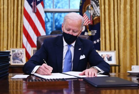 President Biden signs an executive order.