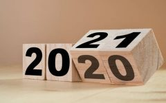 Flipping wooden cubes for new year change 2020 to 2021. New year change and starting concept.