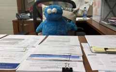 Cookie Monster working hard to give Ms. Spencer a break