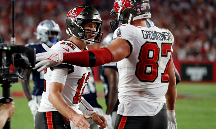 Tampa+Bay+Buccaneers+quarterback+Tom+Brady+%2812%29+celebrates+with+tight+end+Rob+Gronkowski+%2887%29+after+Gronkowski+caught+a+2-yard+touchdown+pass+during+the+first+half+of+an+NFL+football+game+Thursday%2C+Sept.+9%2C+2021%2C+in+Tampa%2C+Fla.+%28AP+Photo%2FScott+Audette%29