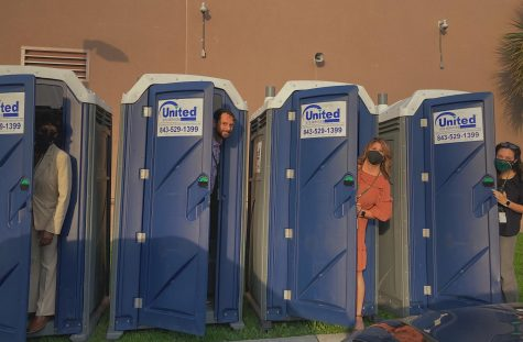 Administrators showing the student body that portapotties really arent so bad.